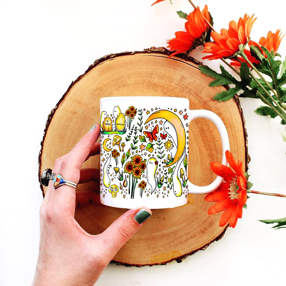 11 oz white mug with hand illustrated colorful Fall imagery including flowers and ghosts